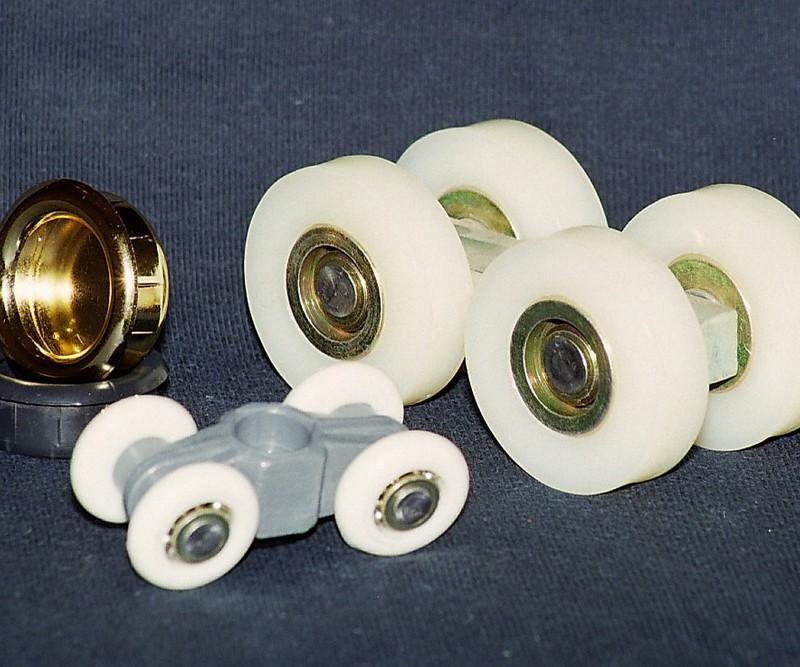 Cubetas, cuerpos y distintos rodamientos para puertas y portones Material: PA66